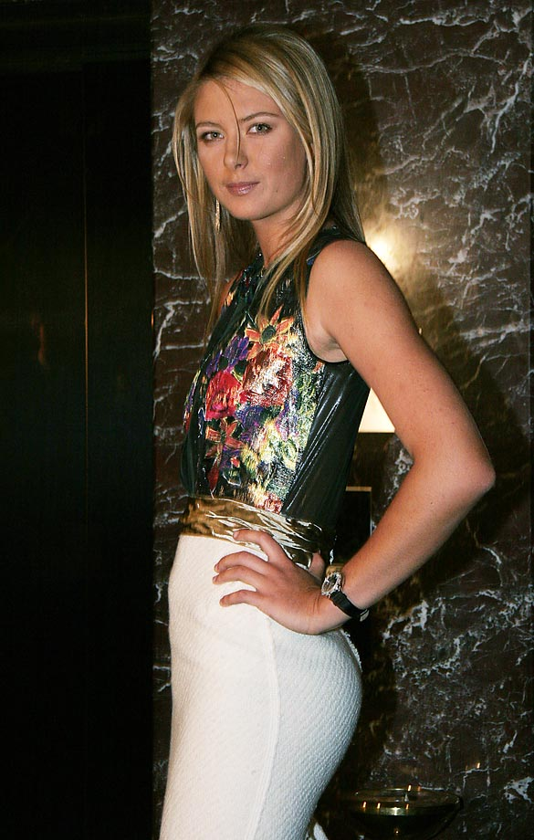 In a rare visit back to her home country of Russia, Sharapova poses at a reception before the Kremlin Cup. Sharapova was 18 and the world's No. 1 player at the time.