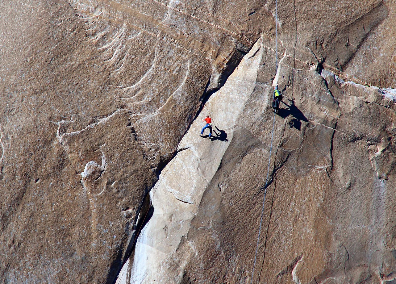 Tommy Caldwell (center in red) on pitch 10.  Camera man Hangs close to his right to get the shot.