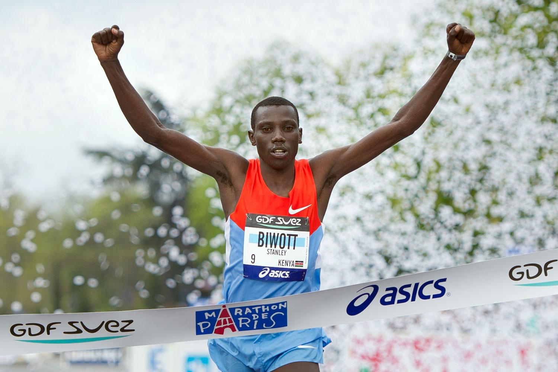 Stanley Biwott crosses the finish line of the 36th Paris Marathon in April 2012.