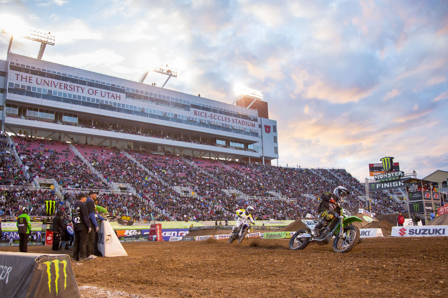 Riders race at dusk at the Monster Energy AMA Supercross race at Rice-Eccles Stadium in Salt Lake City, Utah.