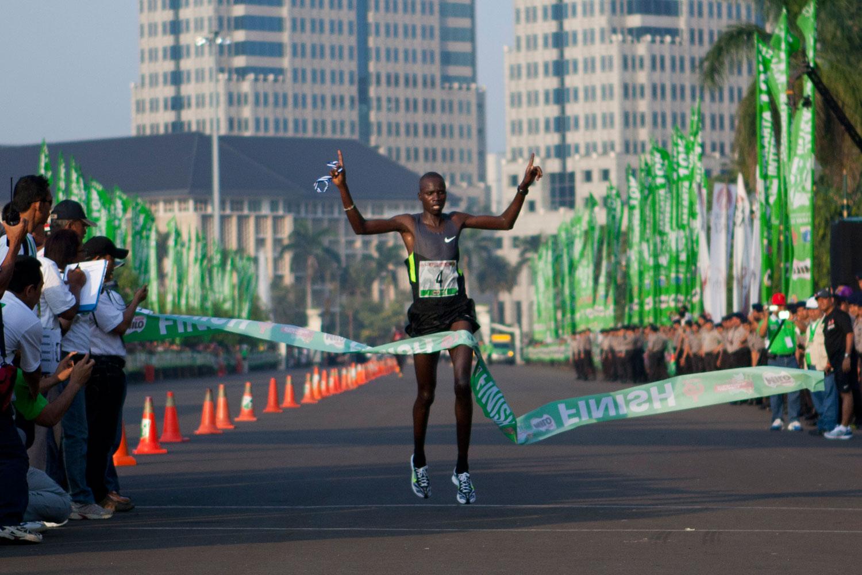 Silas Kipruto crosses the finish line to win the 2012 Jakarta International 10K marathon in May 2012.