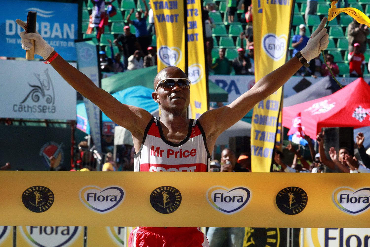 South Africa long-distance runner Ludwick Mamabolo crosses the finish line to win the 89km Comrades Marathon between Pietermaritzburg and Durban on June 3, 2012.