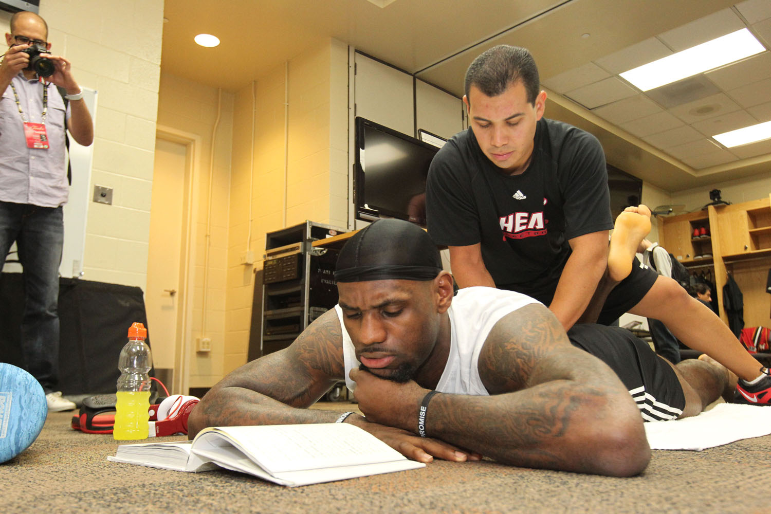 LeBron James gets stretched out in the locker room prior to Game 1 of the 2012 NBA Finals against Oklahoma City Thunder at the Chesapeake Energy Arena on June 12, 2012 in Oklahoma City, Oklahoma.