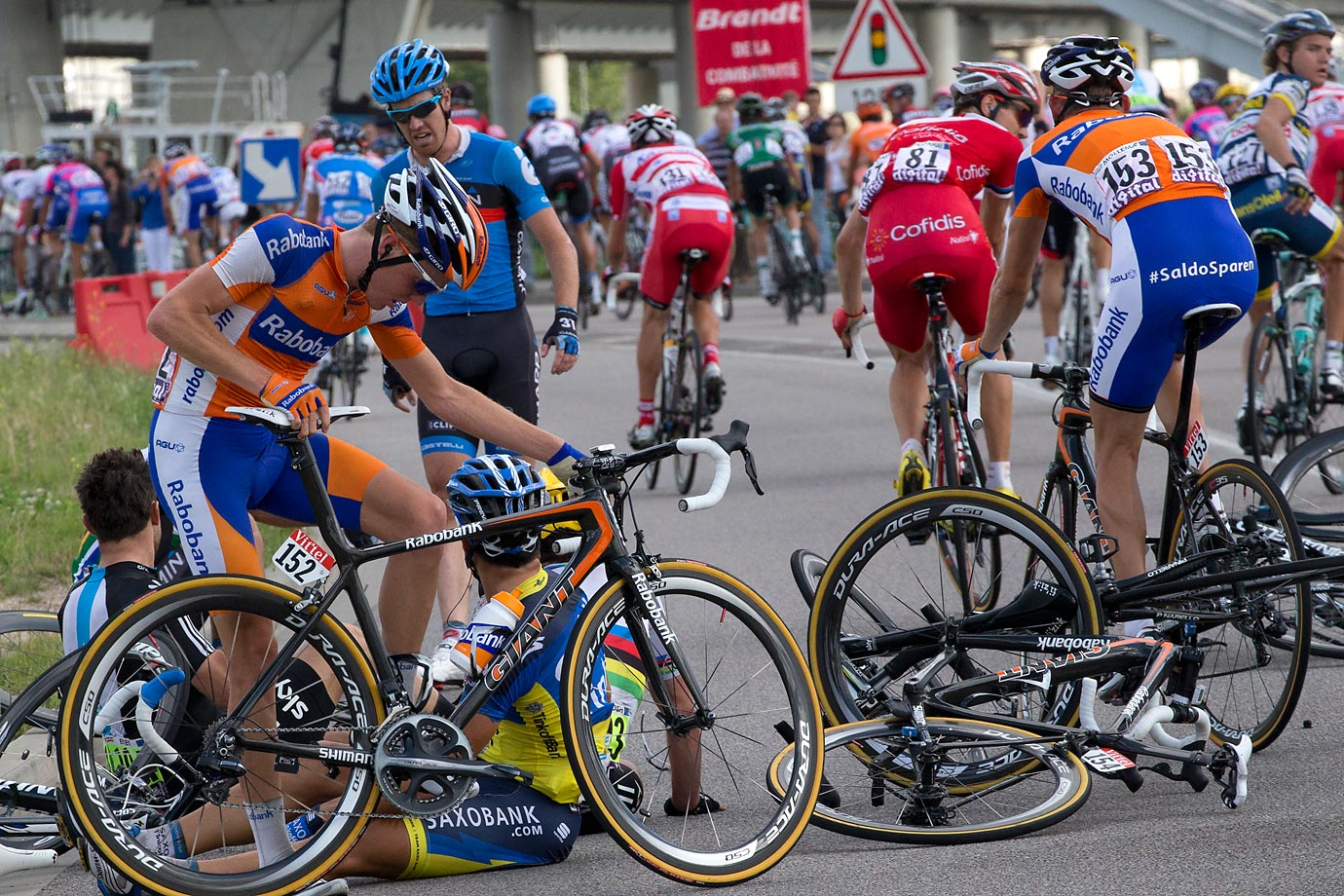 Riders are pictured after they crashed in the 214,5 km and fourth stage of the 2012 Tour de France cycling race starting in Abbeville and finishing in Rouen, northwestern France, on July 4, 2012.