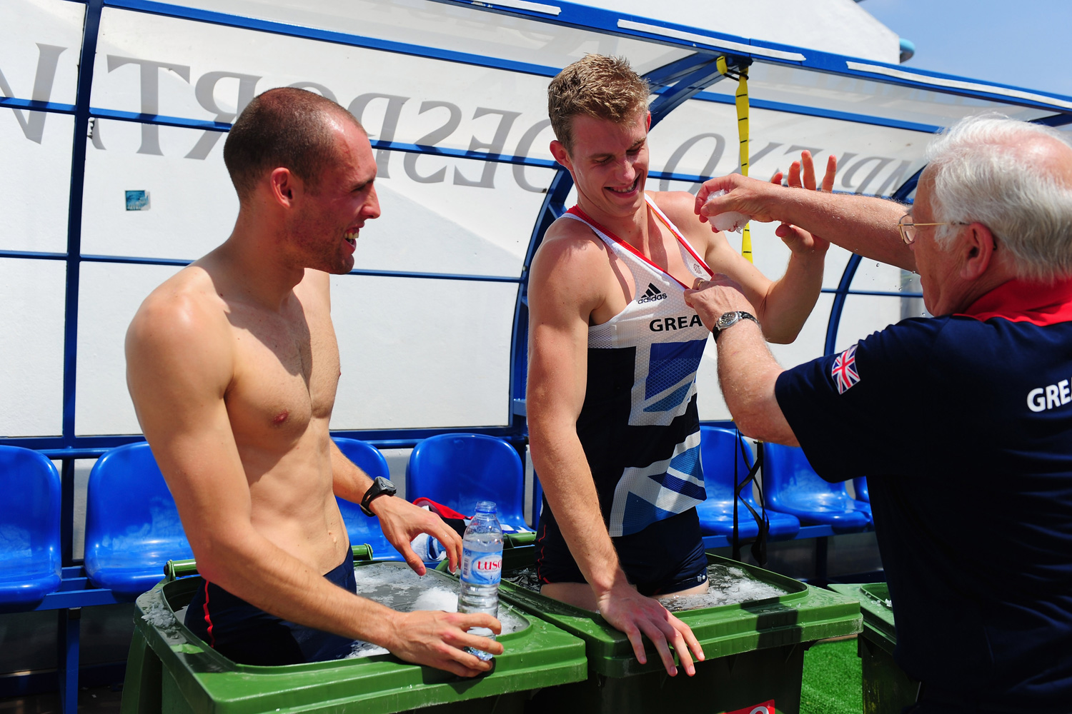 Coach Malcolm Arnold shares a joke and more ice with hurdlers Dai Greene and Jack Green as they suffer in frigid ice baths following a training session.
