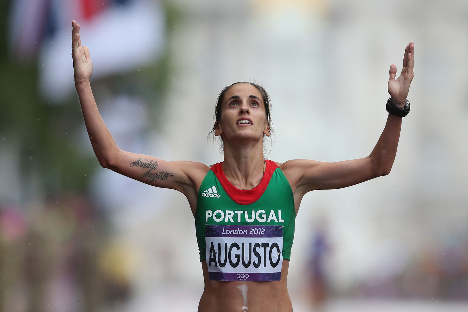 Jessica Augusto of Portugal crosses the finish line during the Women's Marathon on Day 9 of the 2012 London Olympic Games.