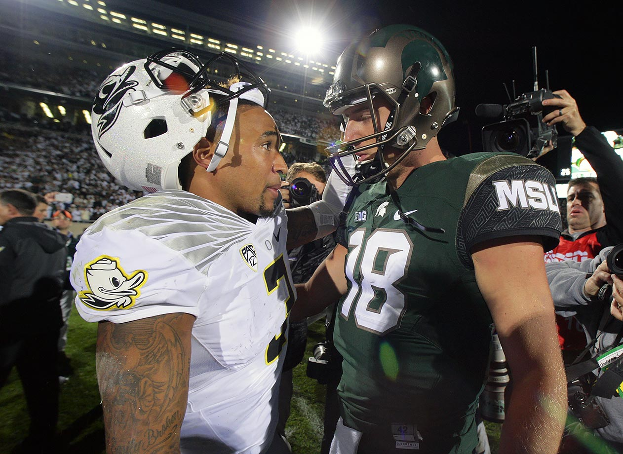 A high-profile nonconference clash brimming with College Football Playoff implications lived up to the hype, even if Oregon ultimately didn't factor into the national championship picture. Michigan State held off the Ducks in East Lansing after Vernon Adams overthrew a receiver near the end zone late in the fourth quarter.
