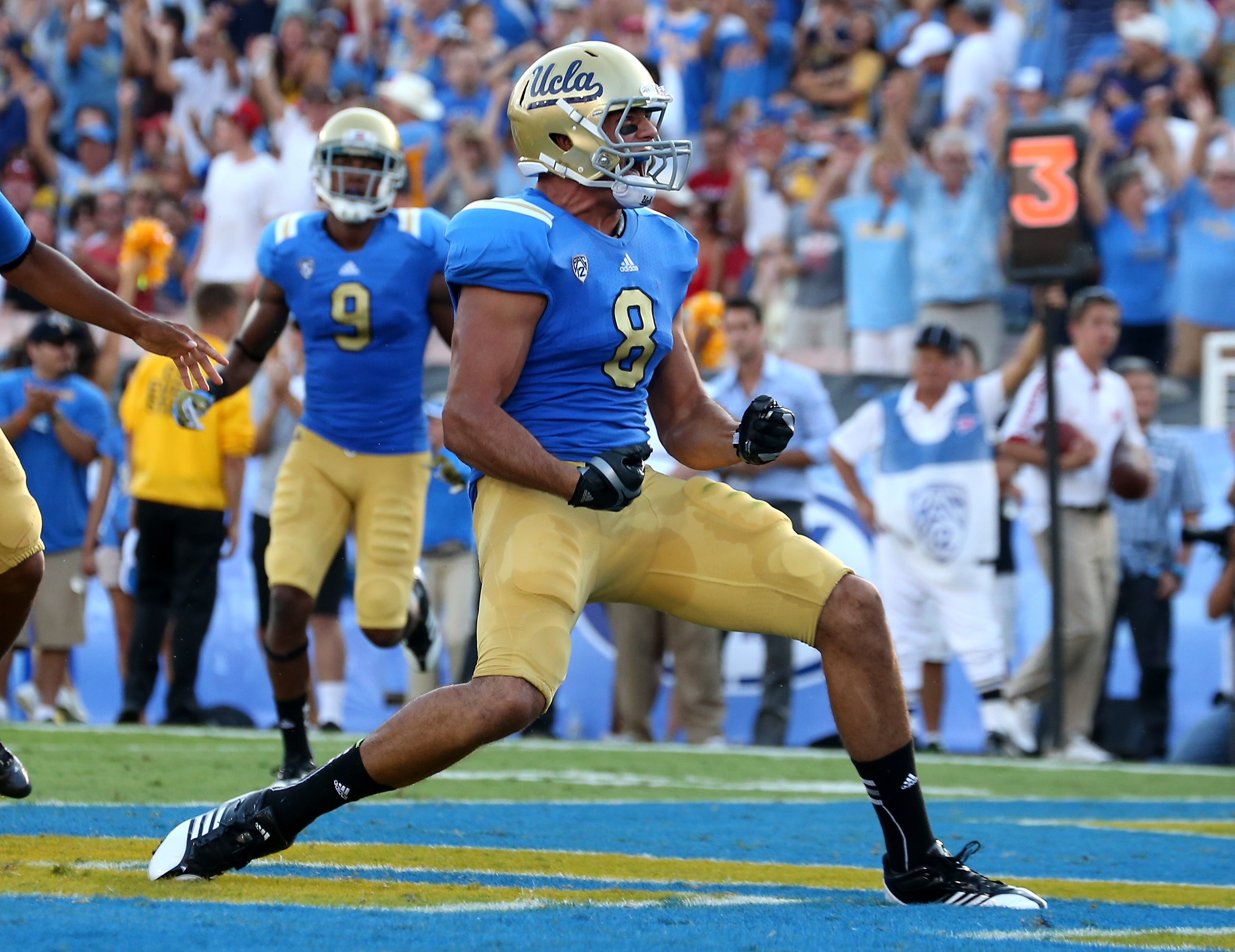 Joseph Fauria (#8) of the UCLA Bruins celebrates a four yard touchdown catch in the second quarter against the Nebraska Cornhuskers at the Rose Bowl on September 8, 2012 in Pasadena, California.