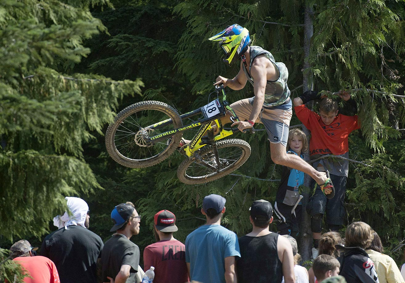 Jack Fogelquist flies above the crowd during the whip off competition at Crankworx in Whistler, British Columbia.