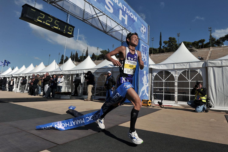 Japan's Akinori Obara crosses the finish line of the 30th Athens Classic Marathon in Athens Panathenaen stadium in 2012.