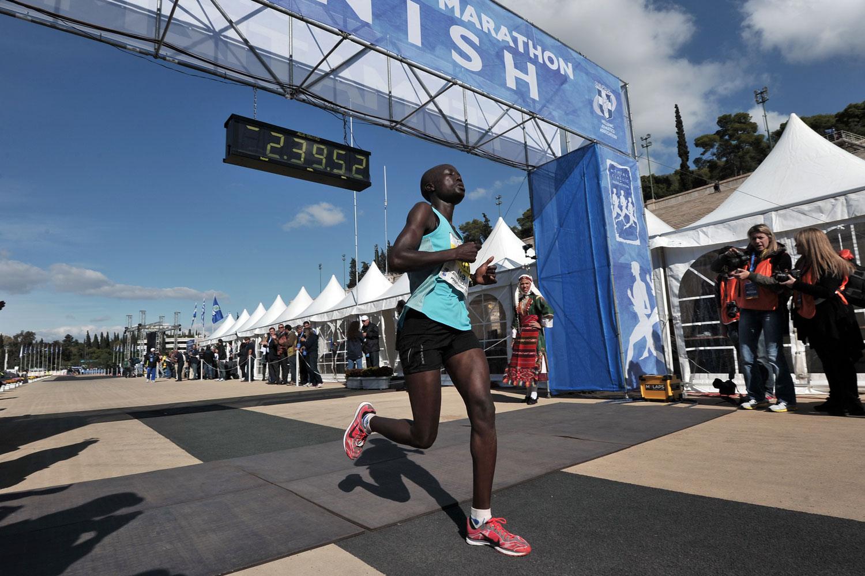 Chelengat Viola Kimetto crosses the finish line of the 30th Athens Classic Marathon in 2012.