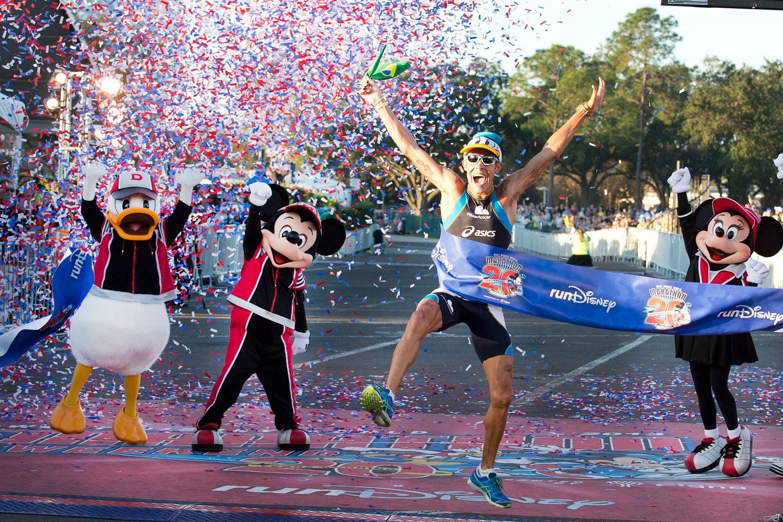 Adriano Bastos crosses the finish line to win the 20th Annual Walt Disney World Marathon at Walt Disney World Resort in Lake Buena Vista, Florida.