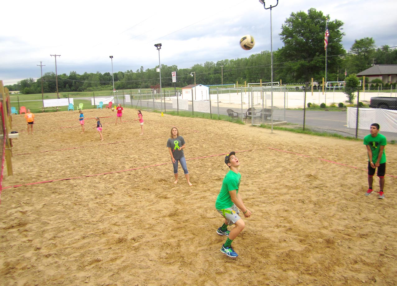 The festivities at Forest View also included free corn hole and beach volleyball. Here, Hunter and his friends hit the volleyball courts.