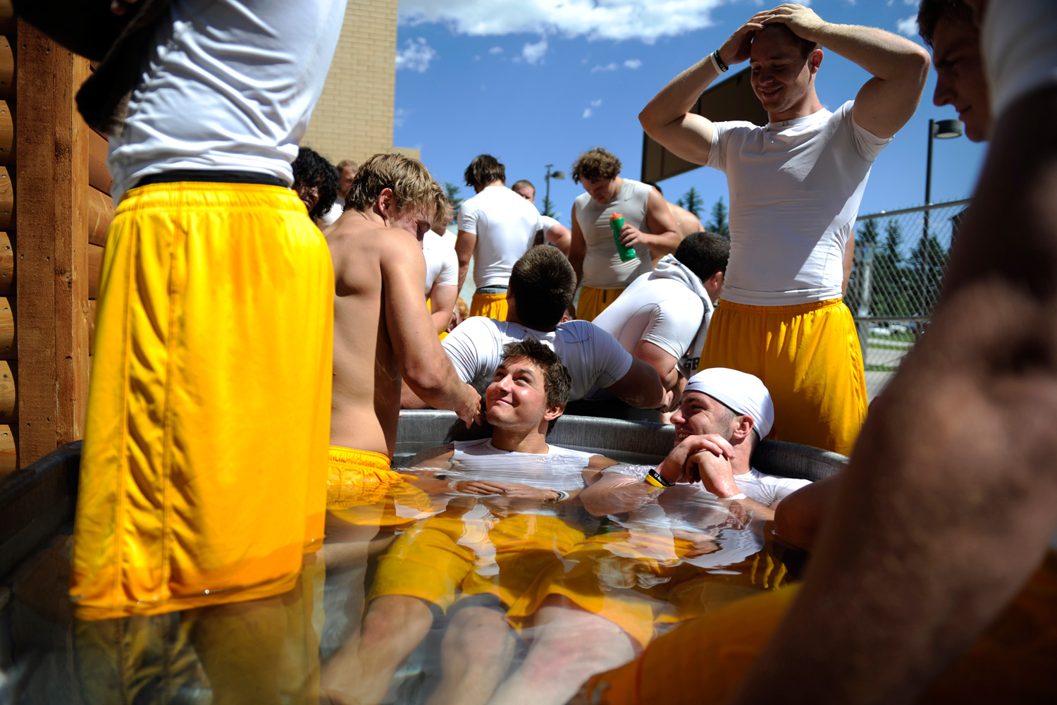 Wyoming wide receiver Sam Stratton (C) jokes with teammates as they take an ice bath at War Memorial Stadium in Laramie, Wyoming.