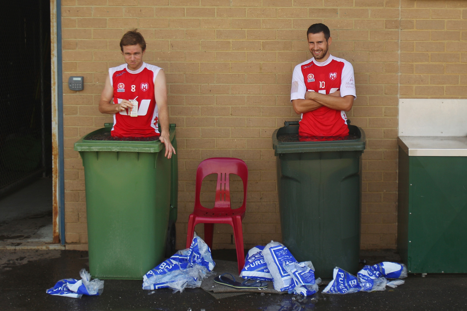 Matt Thompson, who holds the record for most games played in the A-League, and Josip Tadić, formerly of the Melbourne Heart look on as they stand in an ice bath during a training session at La Trobe University Sports Fields in 2013.