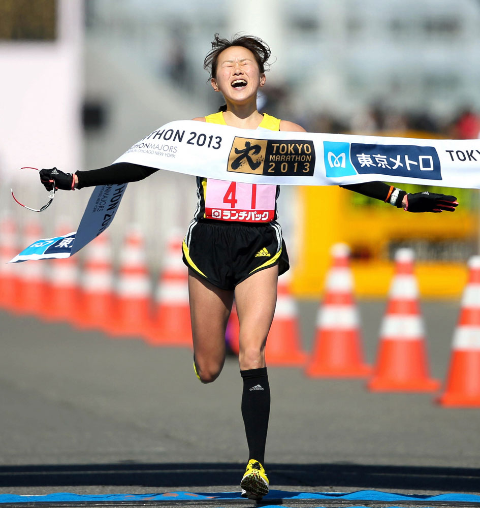 Yoshimi Ozaki crosses the finish line as she finishes 5th at Tokyo Big Sight in Tokyo, Japan.