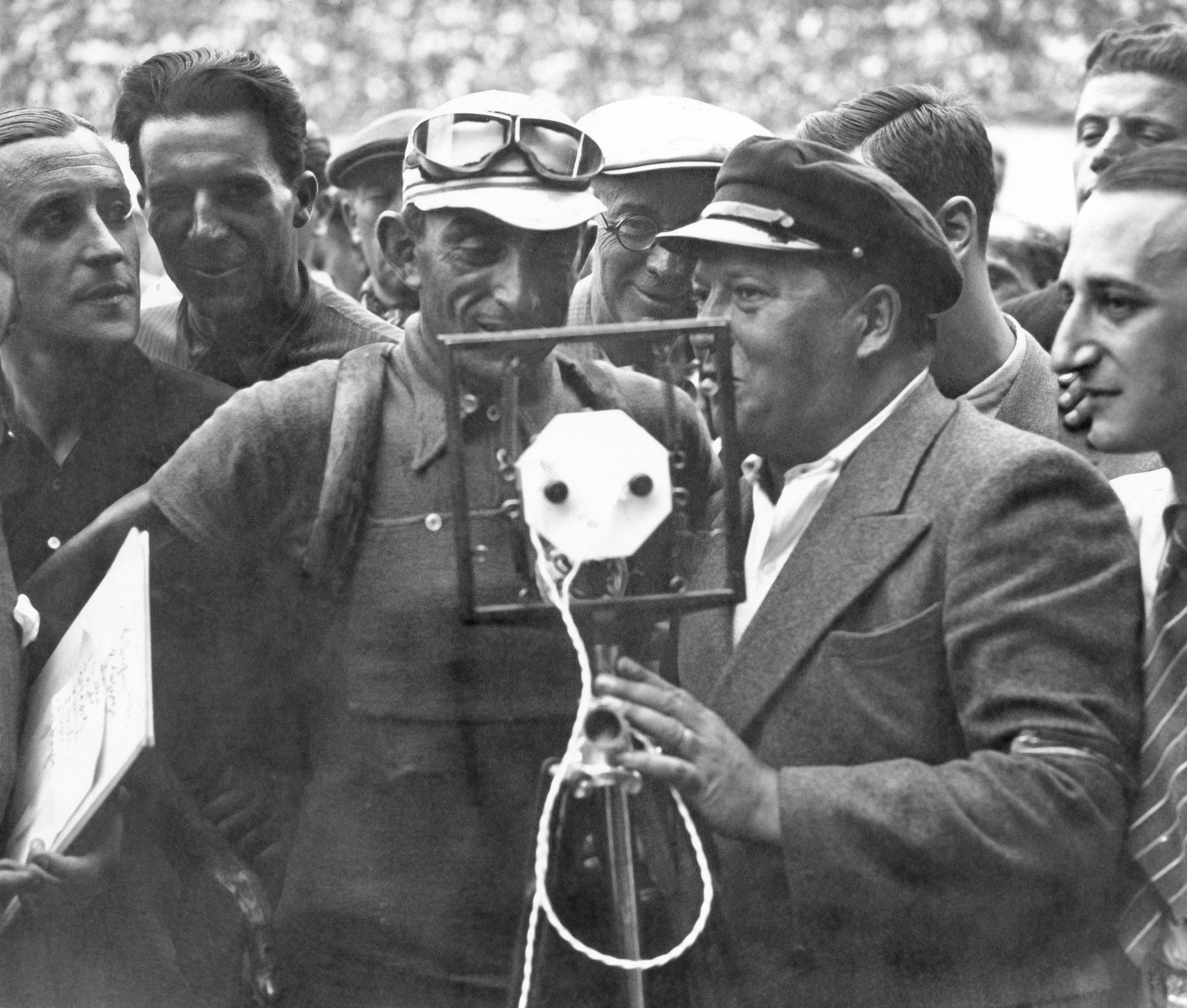 French racing cyclist Antonin Magne (left), winner of the 28th Tour de France is interviewed at the end of the 23rd stage Caen-Paris, on July 29, 1933.