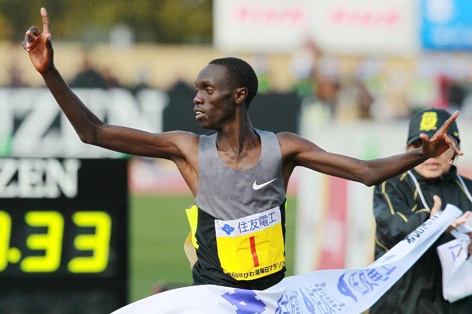 Kenya's Vincent Kipruto gestures as he crosses the finish line of the Lake Biwa Marathon in Otsu, Shiga in March 2013.