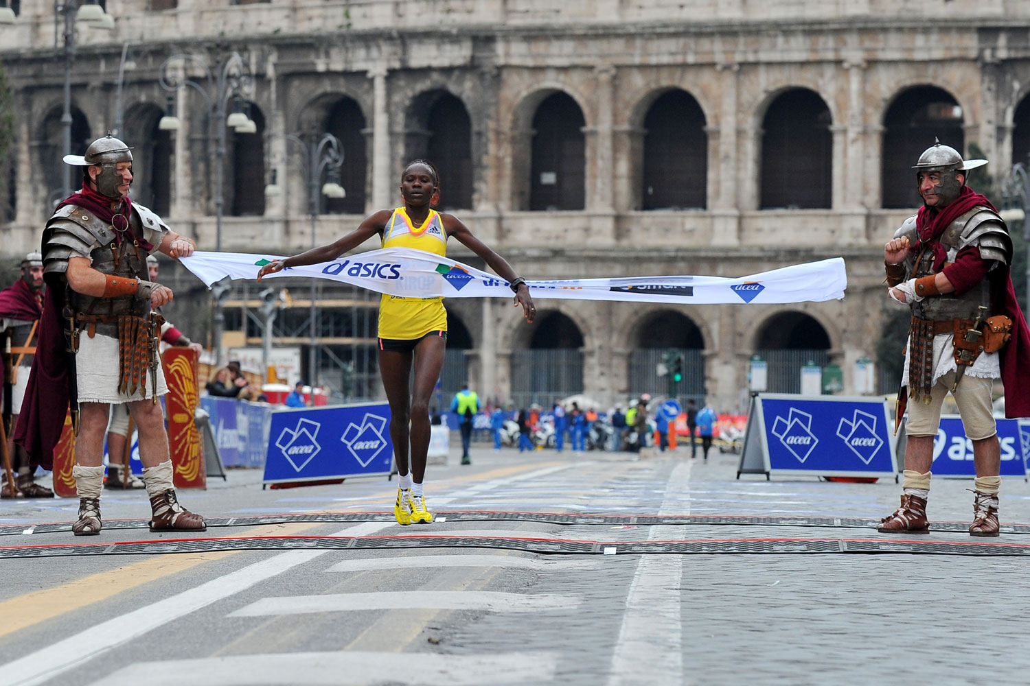 Helena Kiprop crosses the finish line to win the 19th Rome Marathon on March 17, 2013.