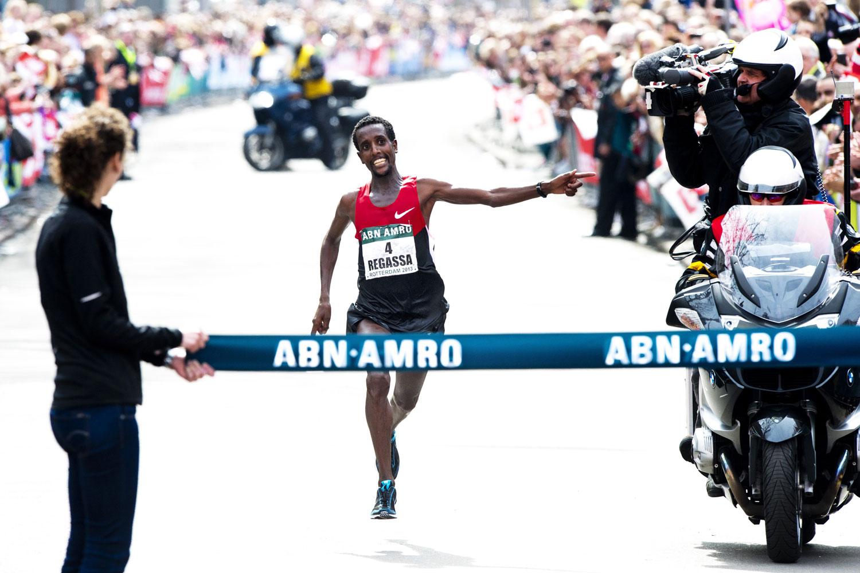 Ethiopia's Tilahun Regassa celebrates as he crosses the finish line to win the Rotterdam Marathon on April 14, 2013.