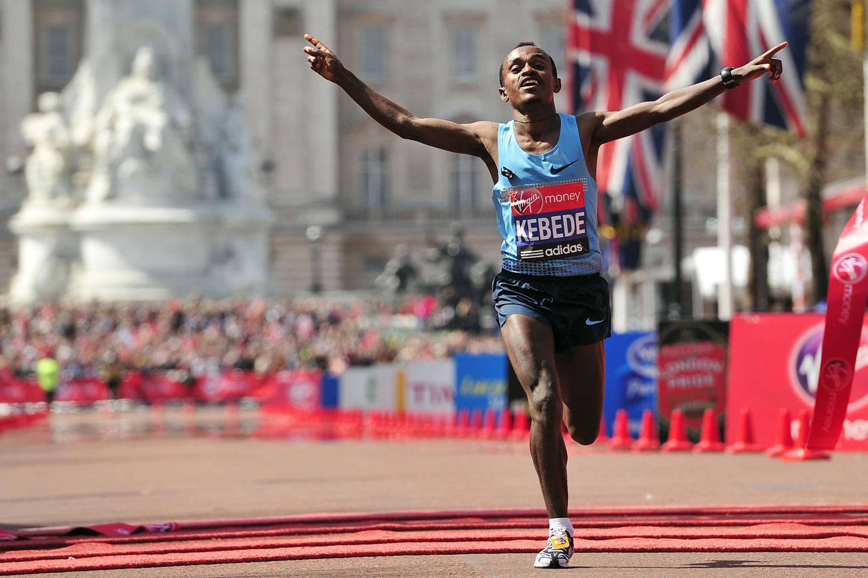 Tsegaye Kebede crosses the finish line to win the men's race in the 2013 London Marathon.