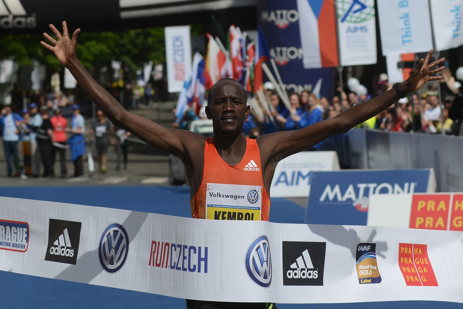 Nicholas Kemboi of Qatar celebrates winning as he crosses the finish line in the Volkswagen Prague Marathon.