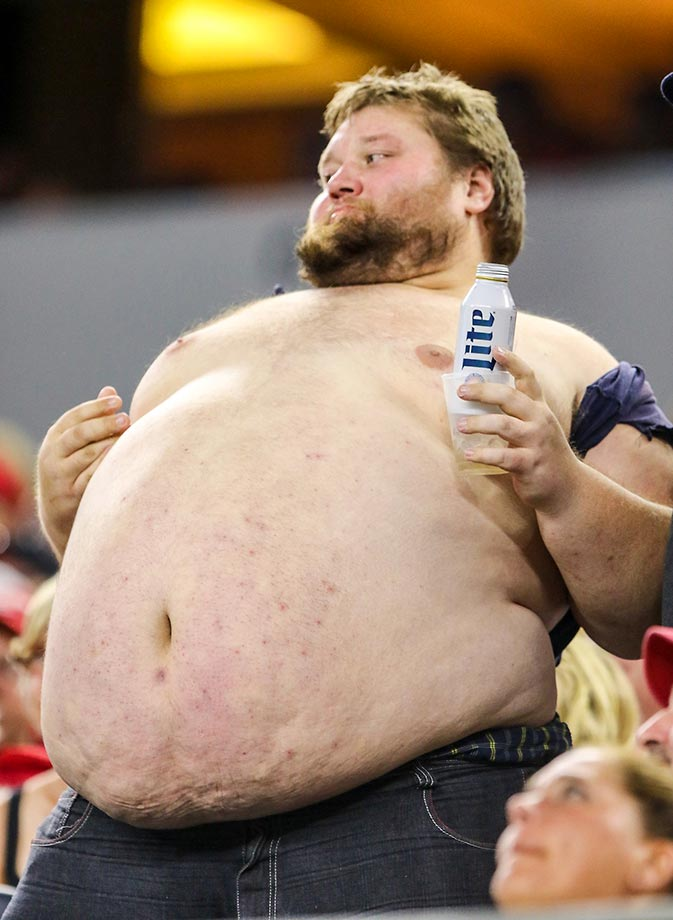 A Wisconsin Badgers fan hanging out at the Alabama game.