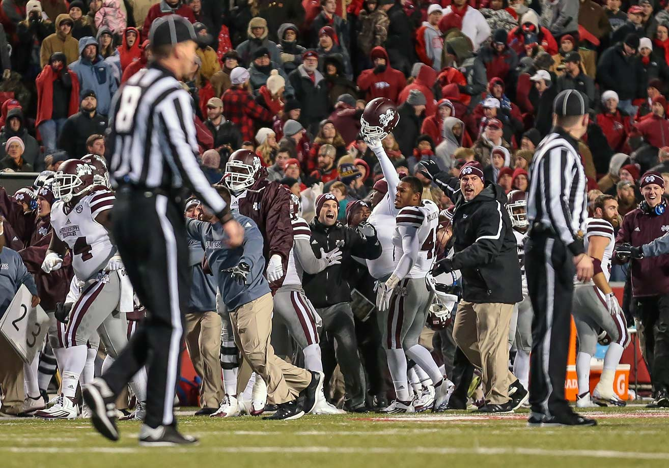 Was this an SEC game or the Big 12? The two teams combined for 101 points, 1,110 yards of total offense and 13 touchdowns in a game decided by Cole Hedlund's blocked 29-yard field-goal attempt. With 39 seconds left, Mississippi State's Beniquez Brown ended Arkansas's hopes and spoiled a career night for quarterback Brandon Allen, who tied an SEC record with seven touchdown passes. The Bulldogs were buoyed by Dak Prescott's 508 yards and five touchdowns.