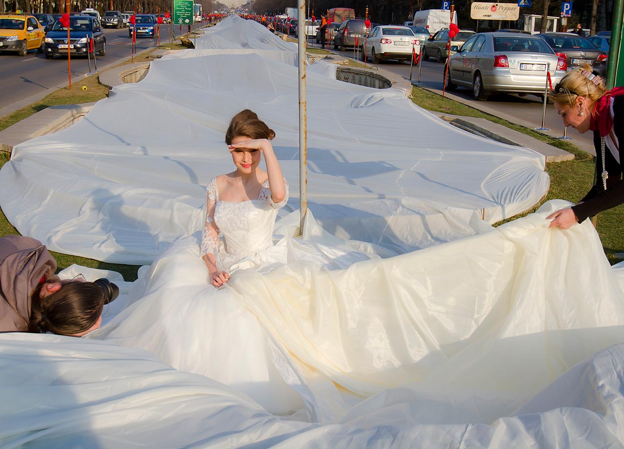 Romanian model Ema Dumitrescu poses with her champion dress during a successful attempt to break the Guinness World Record for the longest wedding dress train. The train measures more than 9,022 feet. Here's a look at other world records that have been broken in the last year and a half.