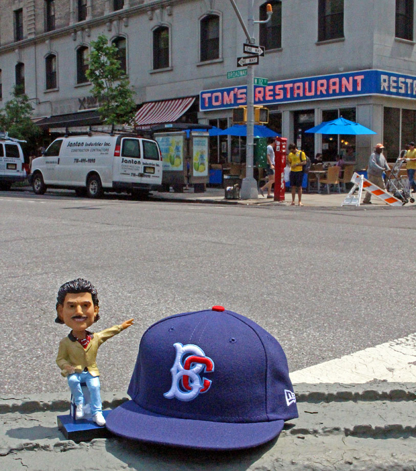 A Keith Hernandez bobblehead and Brooklyn Cyclones hat outside the famous Tom's Restaurant on the Upper West Side.