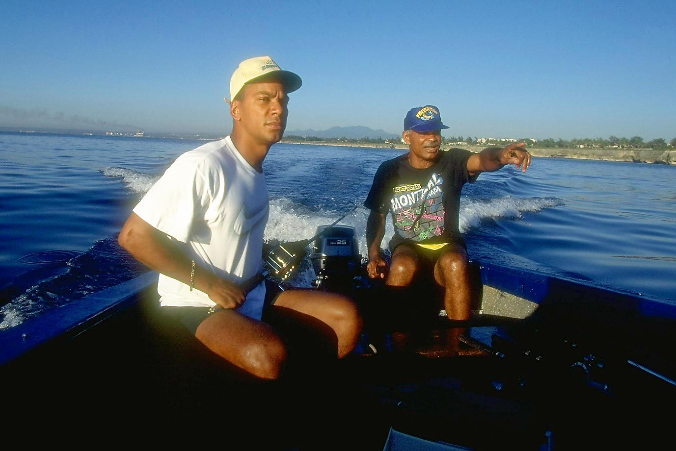 Expos manager Felipe and his son Moises, an outfielder, sit on a fishing boat in the off-season of what-could-have-beens. Montreal had a league-best record of 74-40 when a strike cut off the season without a World Series in 1994.