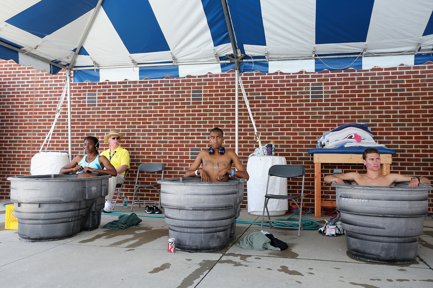 Jaide Stepter, Alexander Monsivaiz and Bryce McAndrew hang out together in a few ice baths on the first day of the 2013 USA Outdoor Track & Field Championships at Drake Stadium.