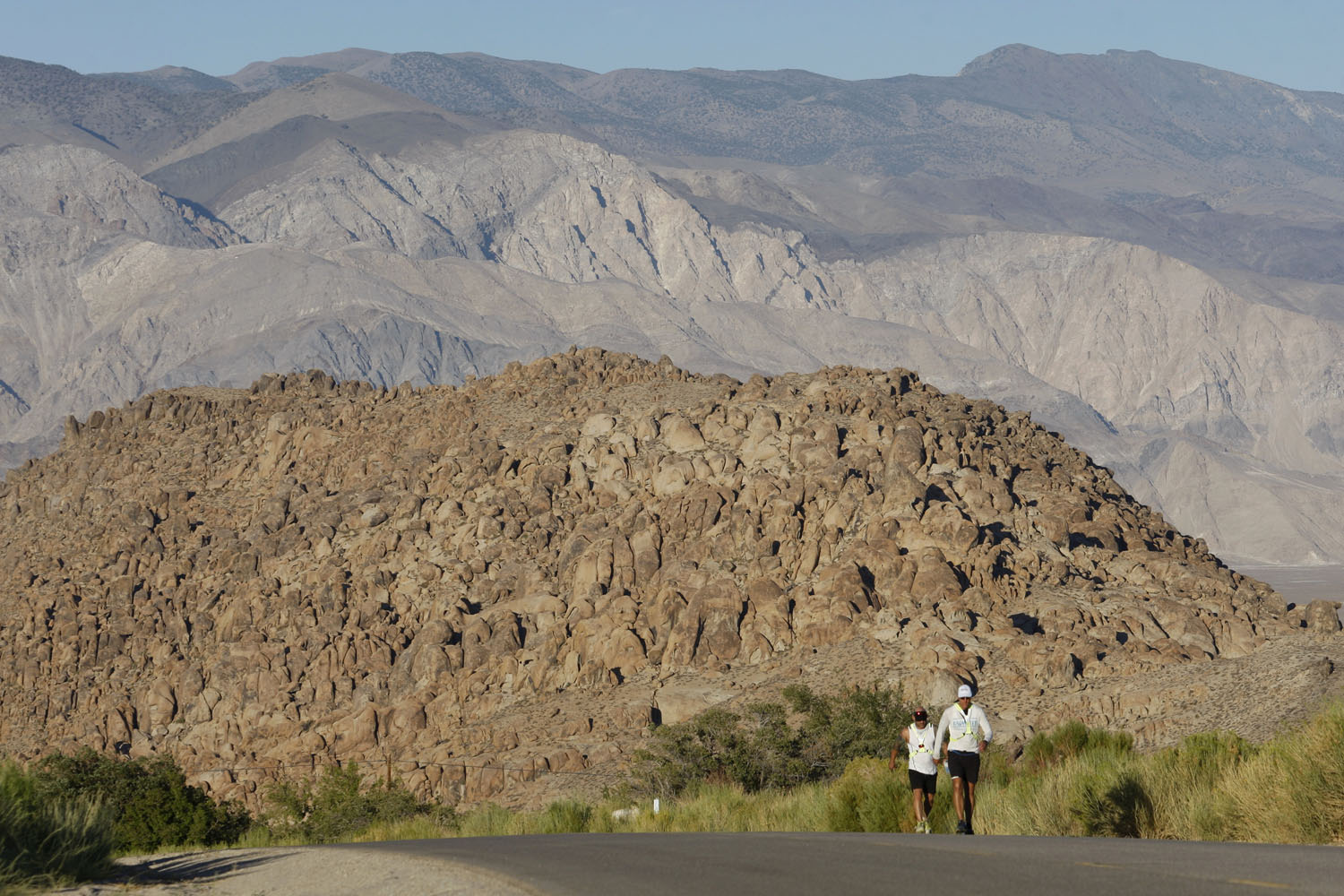 Lane Vogel ascends Whitney Portal Road through the Alabama Hills toward the finish of the AdventurCORPS Badwater 135 ultra-marathon race outside of Death Valley National Park, California.