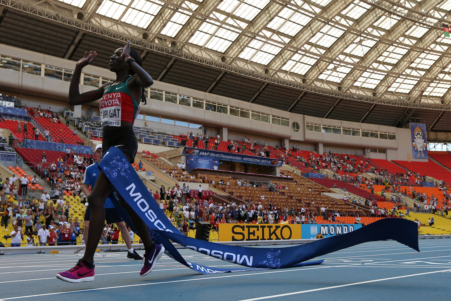 Edna Ngeringwony Kiplagat crosses the line to win gold in the Women's Marathon during the 14th IAAF World Athletics Championships in Moscow, Russia.