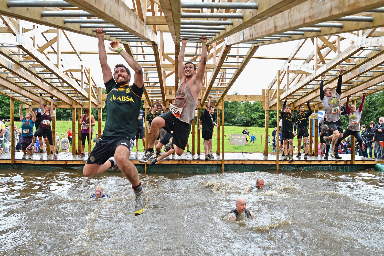 Participents take part in the Tough Mudder endurance event at Dalkieth Country Estate in Edinburgh, Scotland. The world-famous Tough Mudder is military style endurance event over 10-12 miles with various obstacles around the course designed by British Special Forces.