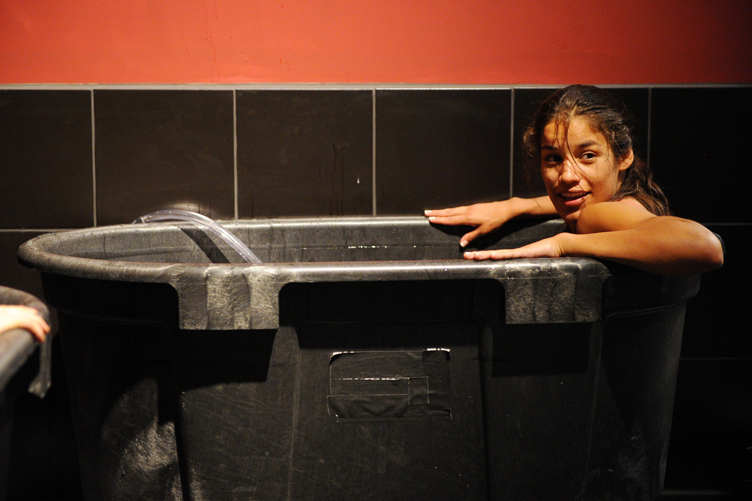 Julianna Pena, the first woman to win The Ultimate Fighter, takes a dip in an ice bath during the filming of season eighteen of the show in Las Vegas, Nevada.