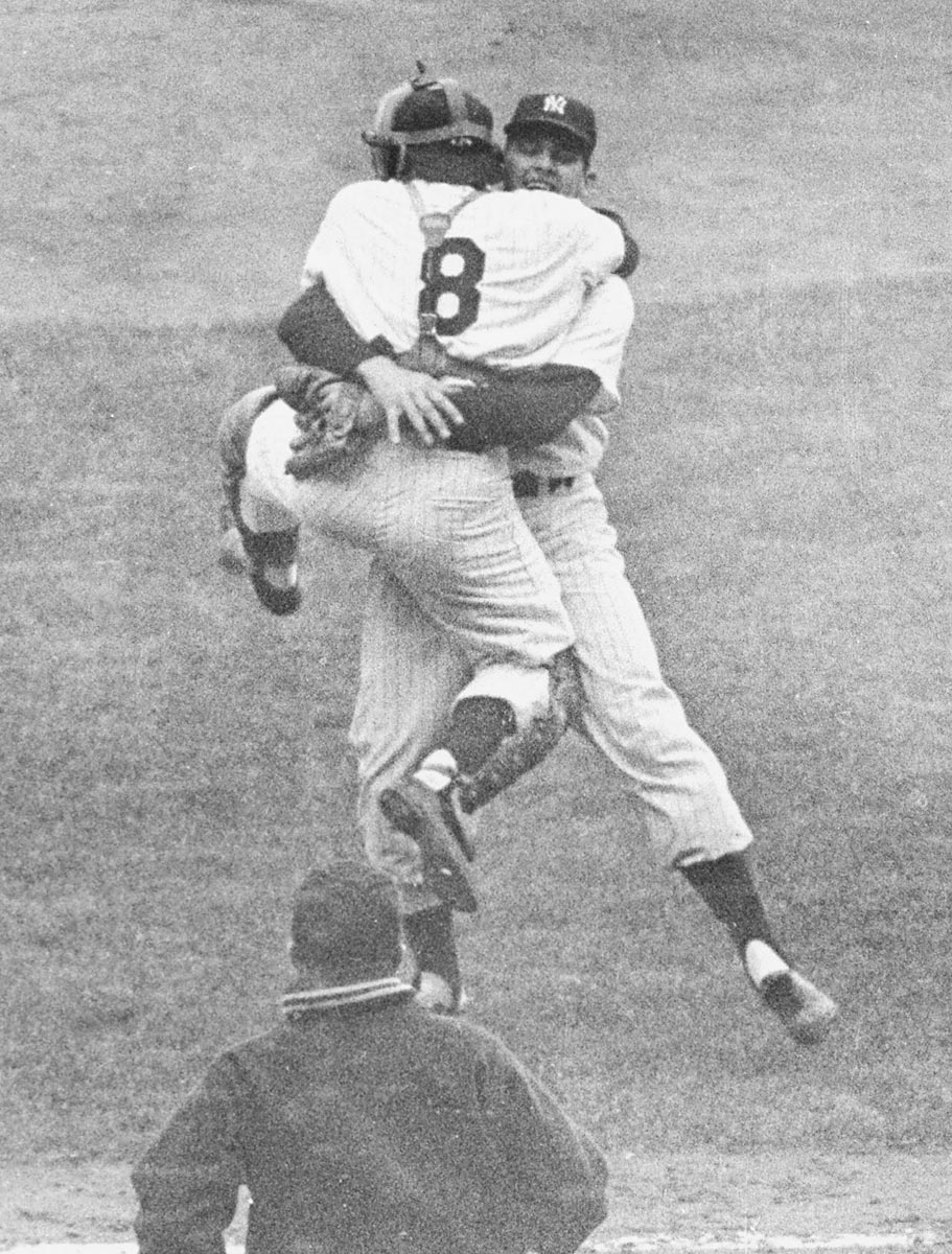World Series Game 5, Oct. 8, 1956 | New York Yankees pitcher Don Larsen hugs catcher Yogi Berra (8) after pitching the only perfect game in World Series history, at Yankee Stadium. The Yankees would win the Series in seven games.