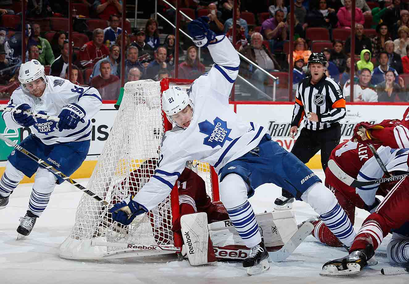 Falling Leaf: Toronto's James van Riemsdyk lands on goaltender Mike Smith of the Arizona Coyotes during the third period of their game at Gila River Arena in Glendale, Arizona on November 4, 2014. The Maple Leafs fell, 3-2.