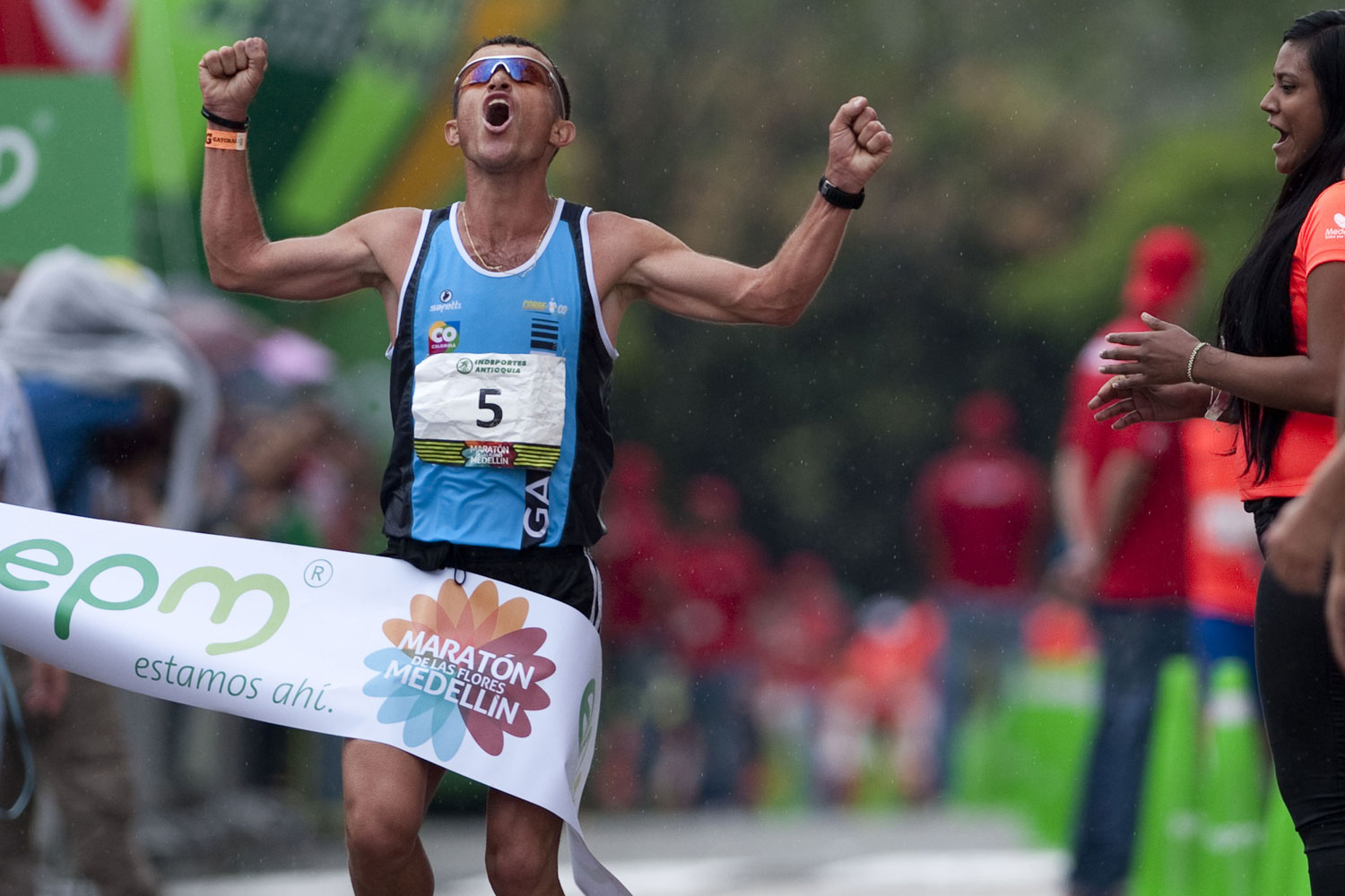 Colombian runner Juan Carlos Cardona crosses the finish line to win Medellin's Flowers Marathon in 2013.