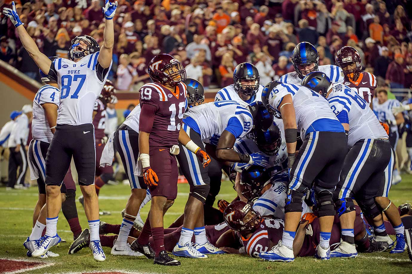 The normally defensive led Blue Devils got four touchdown passes from quarterback Thomas Sirk before he ran for the game-winning two-point conversion to defeat Virginia Tech in the longest game in ACC history. The Hokies scored the first touchdown in the fourth overtime, but with the rules mandating that teams go for 2-point conversions after two overtimes, Virginia Tech quarterback Michael Brewer attempted to sneak a pass into Isaiah Ford that was knocked away by Duke's Deondre Singleton.