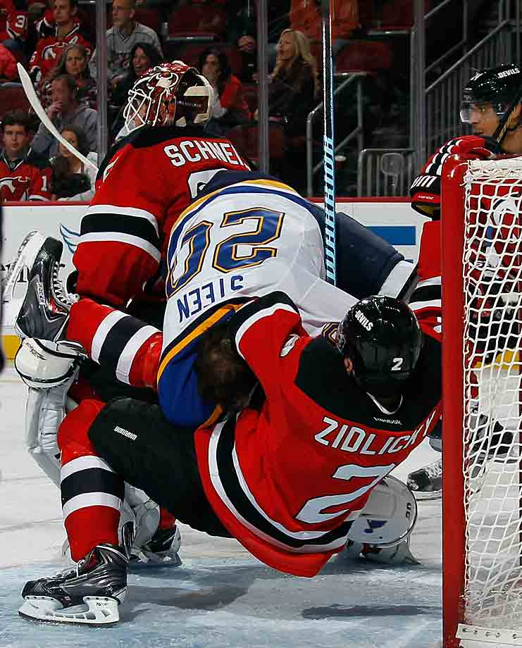 Devils defenseman Marek Zidlicky received a two minute penalty for not-so-subtly holding Alexander Steen of the St. Louis Blues during the third period of their game at New Jersey's Prudential Center on November 4, 2014.