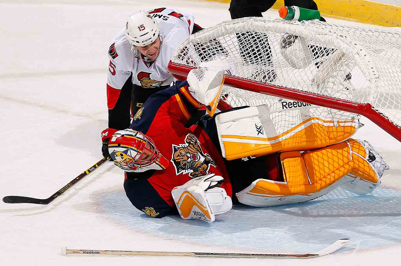 Caged Panther: Goalie Roberto Luongo was trapped by Ottawa's Zack Smith at the BB&T Center on Oct. 13.