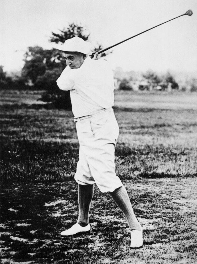 Warren Harding, the 29th President of the United States, plays golf in 1922.