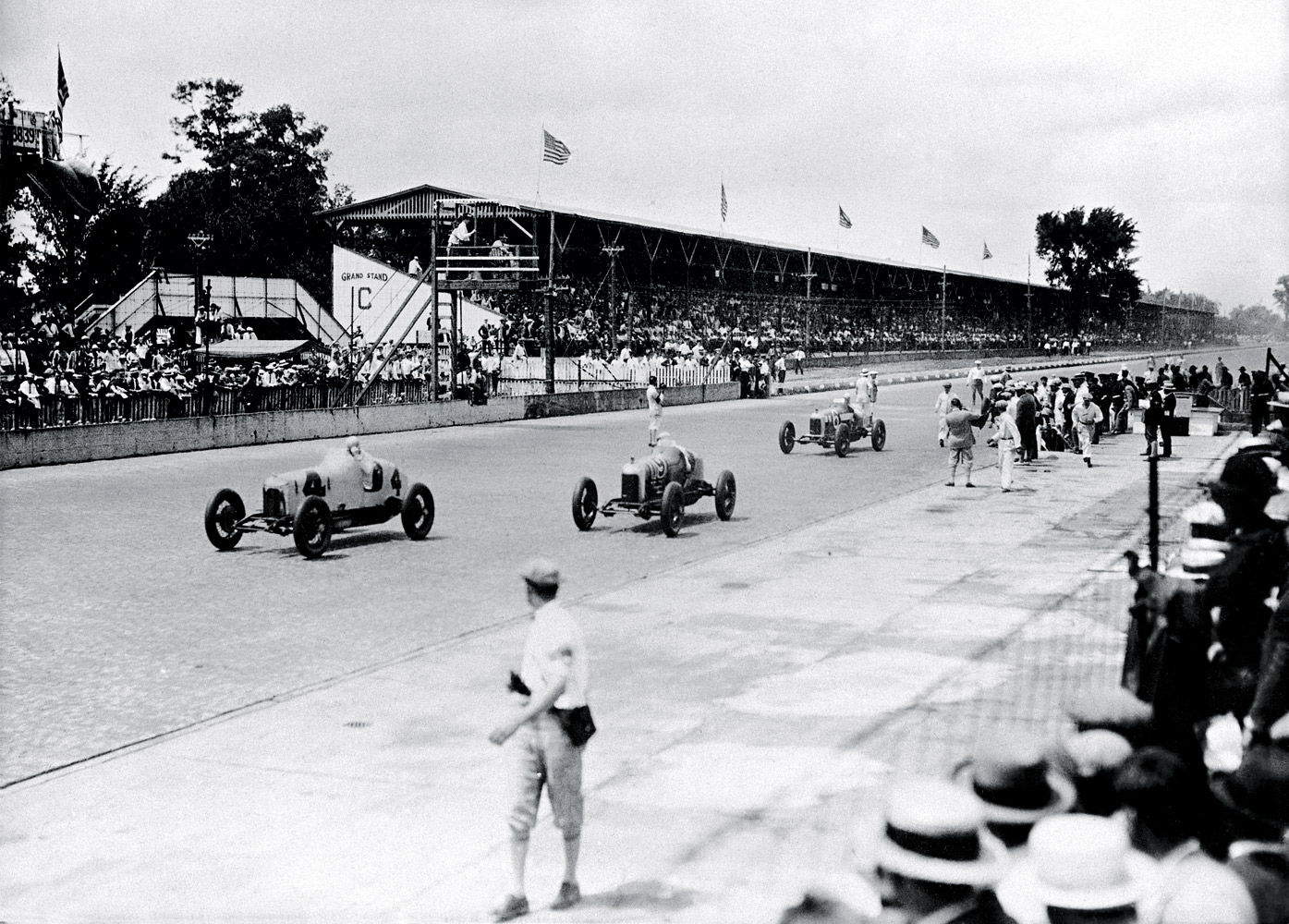The track isn't the only place to find cars during a race: In the Roaring '20s fans parked their Model T's in the infield. Back then the racing surface exposed a while lot more than a yard of bricks-repaving in asphalt was still a decade away, as was swigging dairy for champs. Rookie Louis Meyer, who would later start the ritual when he became the 500's first three-time winner, was a milkless victor in '28.