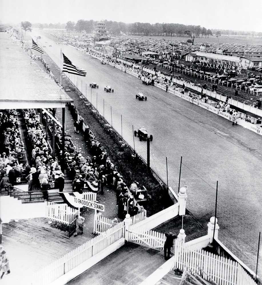 """The """"paddock"""" overlooked this straightaway, and in a messy race Billy Arnold broke an axle, Wilbur Shaw went over a wall and Louis Schneider won."""