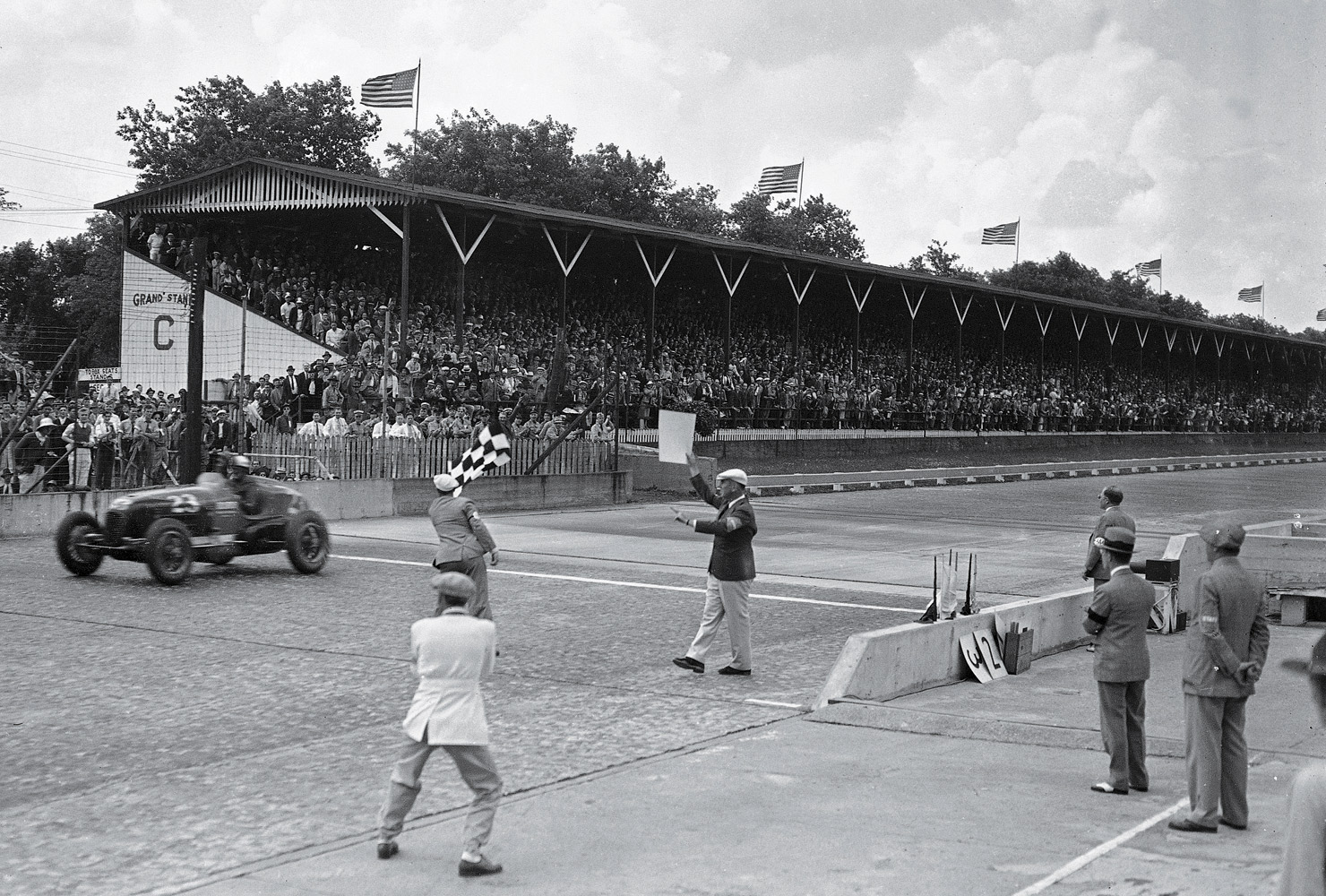 With no traffic to challenge Floyd Roberts at the finish, the started signaled his victory while moving safely toward the middle of the track.