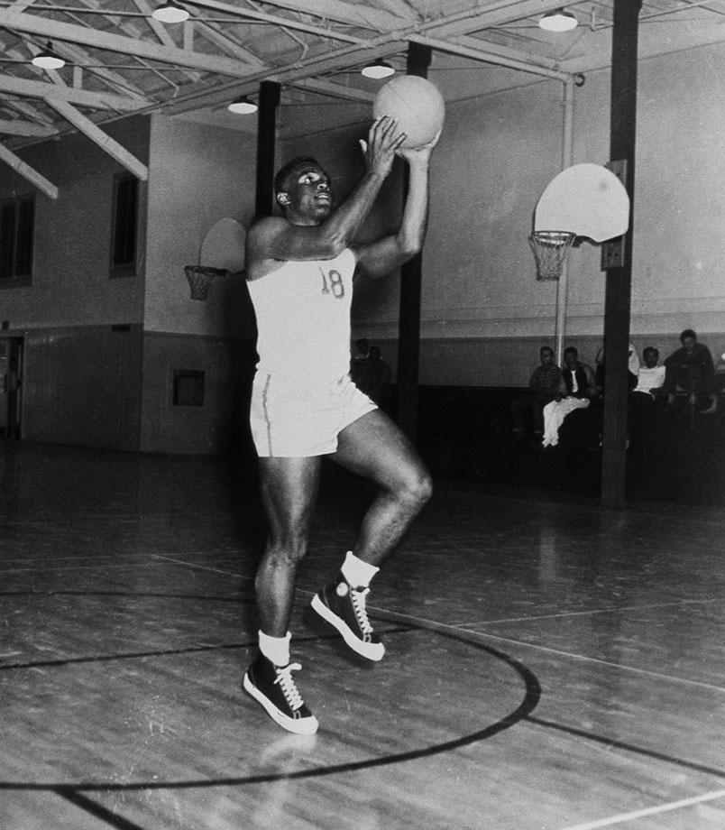 Jackie Robinson shoots the ball while practicing for the UCLA basketball team in 1939.  In two years at UCLA, Robinson became a four-letter athlete in track and field, football, basketball and baseball—the first and only in the school's history.