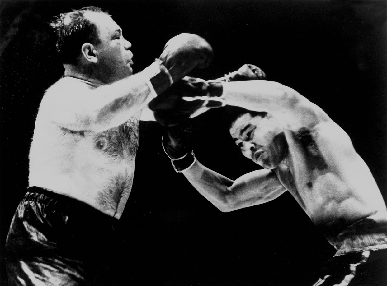 "From January 1939 through May 1941, Louis would defend his title 13 times. The parade of vanquished challengers became known as the Bum of the Month Club. Among the more colorful of these contenders was ""Two-Ton"" Tony Galento, an Orange, N.J., bartender who trained on beer and cigars and was famous for wrestling an alligator and boxing a kangaroo. He found himself in against something very different against Louis. Though he famously promised to ""moida da bum,"" and did rock Louis with a left hook, Galento should have stuck to the zoo. Louis battered him into a KO in the fourth round."
