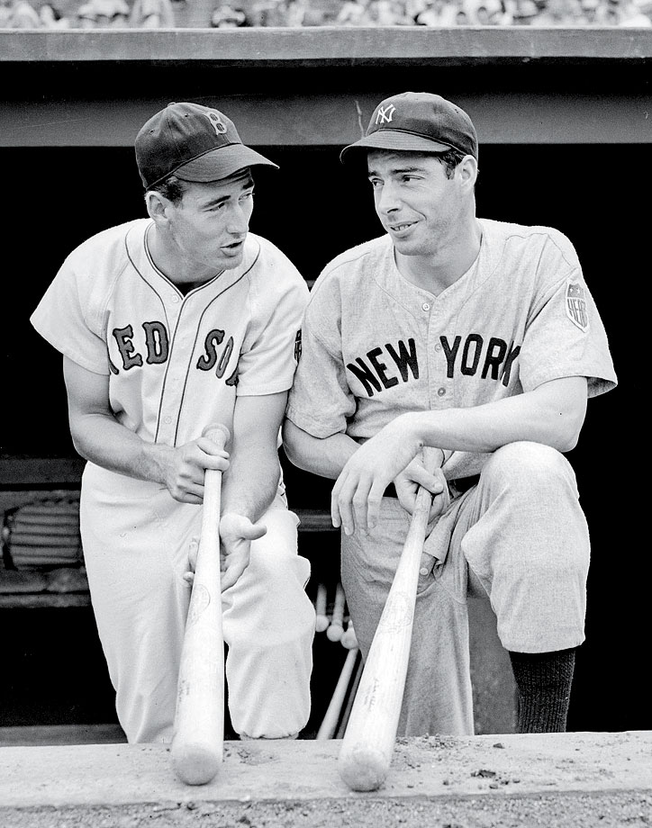 Ted Williams and Joe Dimaggio chat in the dugout before their game on Aug. 18, 1942 at Fenway Park in Boston.