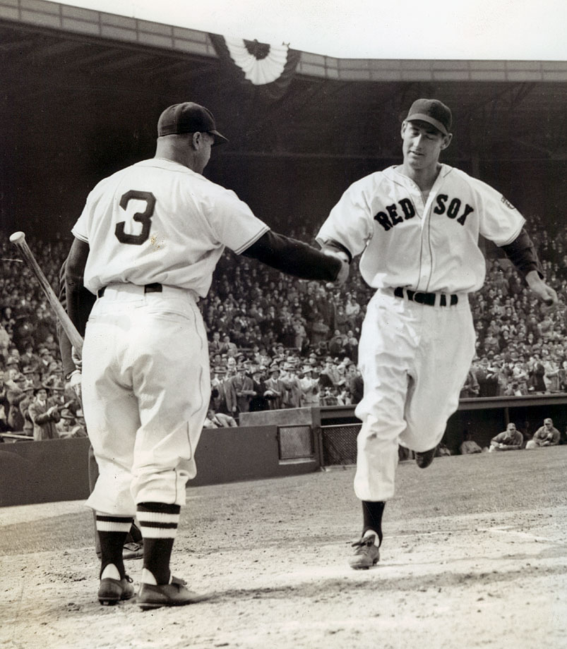 After hitting a three-run homer on Opening Day 1942, Ted Williams is greeted by Jimmie Foxx.